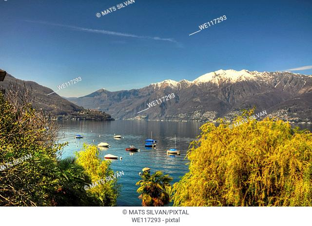 Lake with snow-capped mountain and blue sky