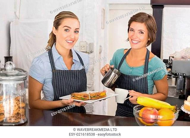 Pretty waitresses working with a smile