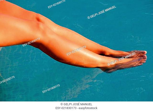 Nice tanned legs under the water