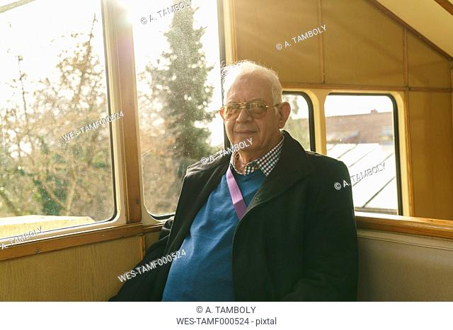Germany, Dresden, senior man sitting in cable railway