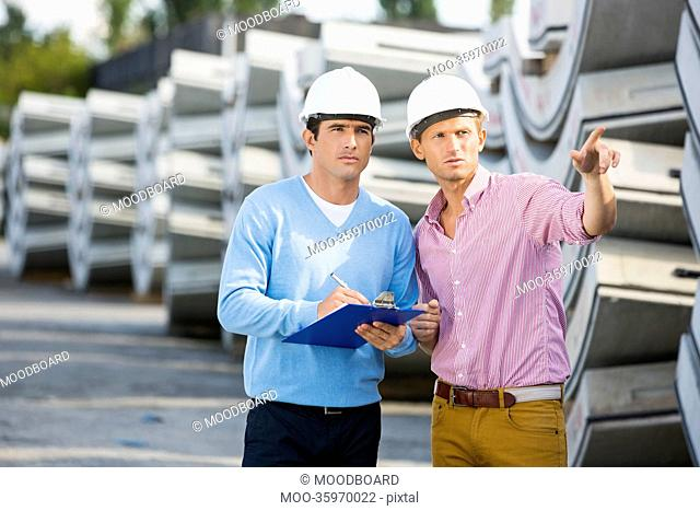 Architects inspecting stock at site