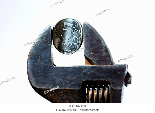 The coin in vise on the white background as a symbol of economic sanction against of Russia