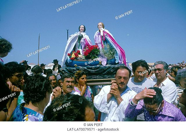 Les Saintes Maries de la Mer. Annual religious event. Effigies of two Maries being taken to the sea. Crowd