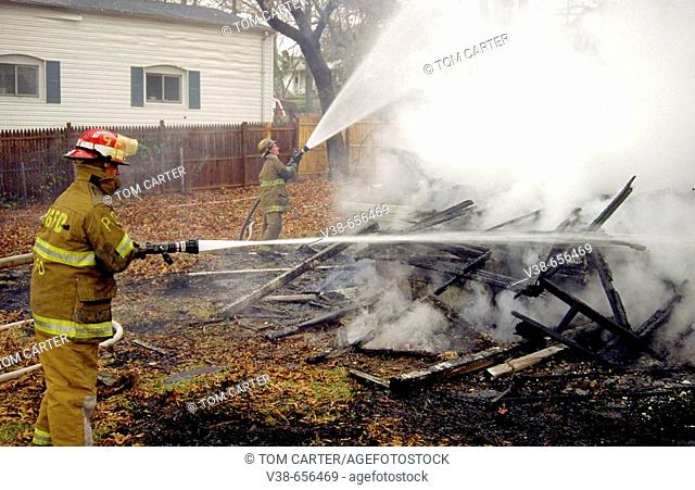 Firefighters pour water on whats left of a house in Bladensburg, Md USA