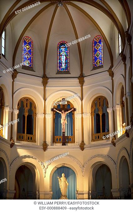 Stained Glass, Christ Crucifix, Mary Statue, Notre Dame Cathedral, Nha Tho Duc Ba, built in 1883 largest cathedral in French Empire Saigon Ho Chi Minh City...