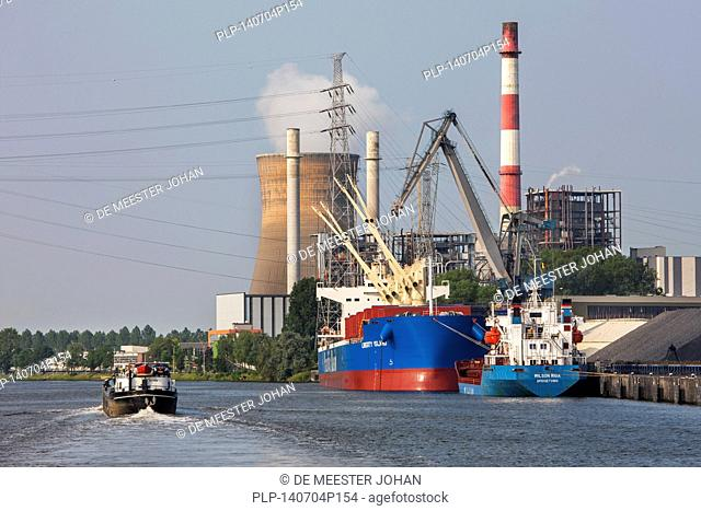 Electrabel power station and Pacific Basin bulk carrier docked at SEA-invest / Ghent Coal Terminal at the port of Ghent, East Flanders, Belgium