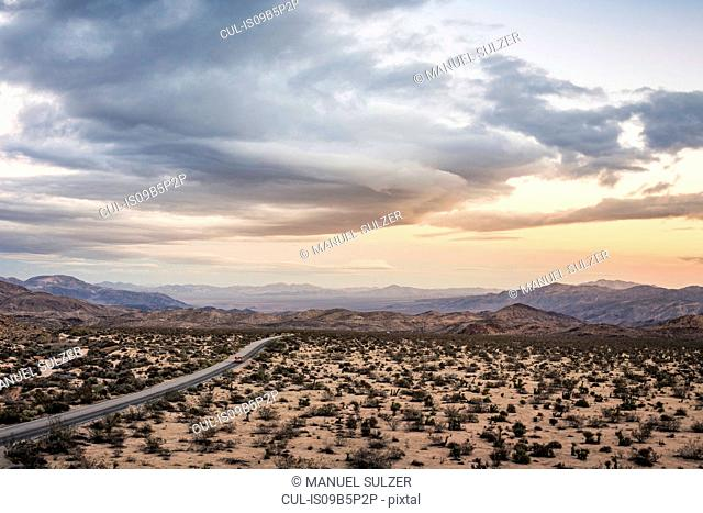 Landscape view of distant highway in Joshua Tree National Park at dusk, California, USA