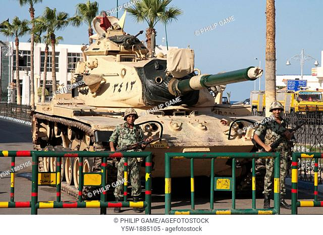 Egyptian soldiers keep watch beside a tank in the streets of Mersa Matruh during the 'Second Revolution' of November 2011