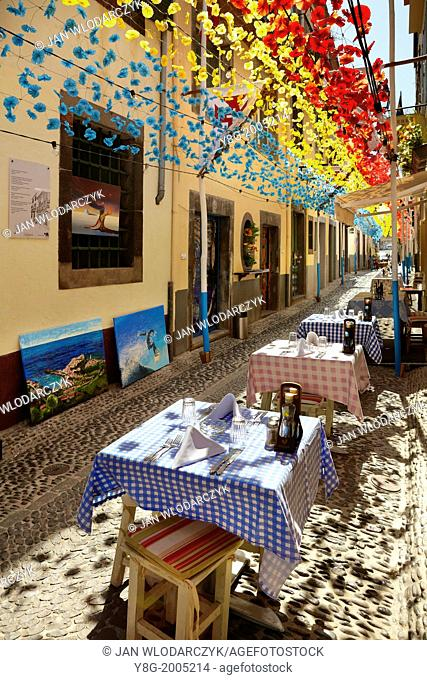 Street decorated with paper flowers on feast of Madeira, Funchal old town, Madeira, Portugal