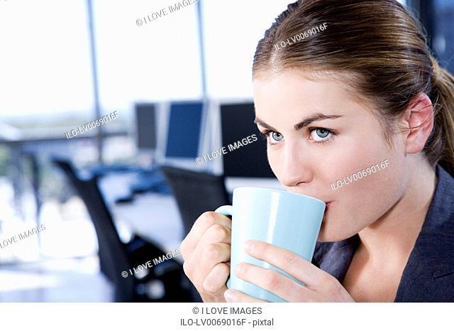 Businesswoman having a tea or coffee break