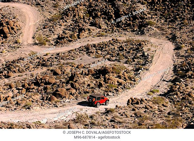 Jeep heading down winding desert trail, Amboy, CA, USA