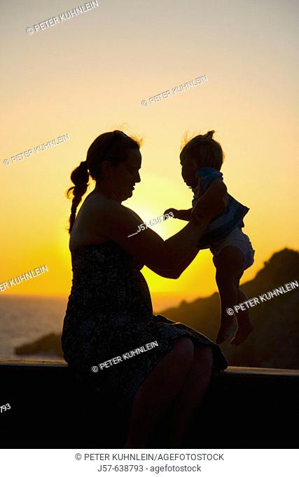 Mother and daughter in the sunset on the island of Kalymnos. Greece