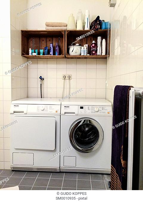 Tilburg, Netherlands. Washing machine and dryer of a German brand in a domestic bathroom
