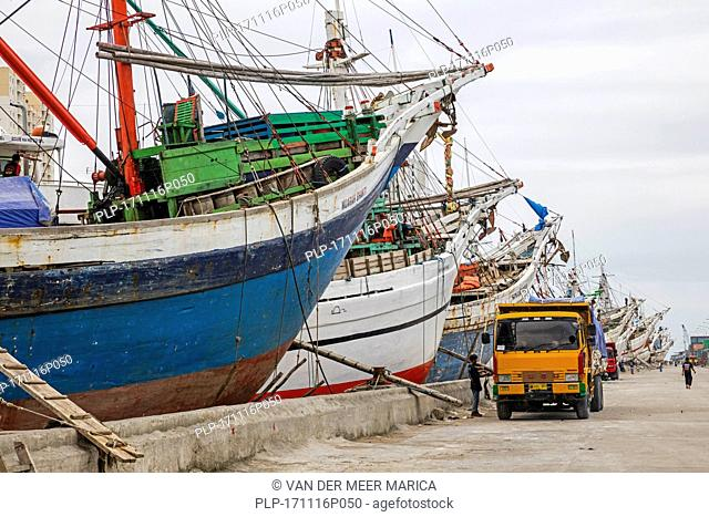 Wooden pinisis / phinisis, traditional Indonesian two-masted sailing ships at Sunda Kelapa / Sunda Kalapa, old Batavia harbour at Jakarta, Indonesia