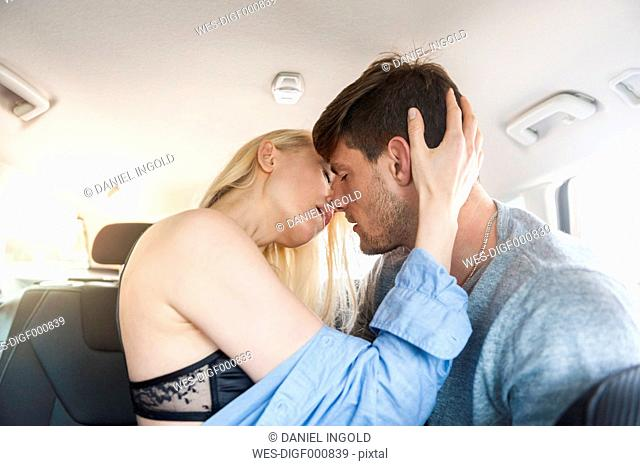 Intimate couple in a car