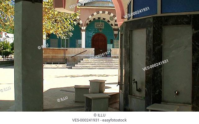 Washing facilities outside colourful Turkish mosque 2