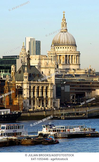 London Skyline from Waterloo bridge showing buildings surrounding St Paul's Cathedral in late afternoon sunshine