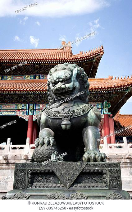 Bronze lion statue in front of Gate of Supreme Harmony in Forbidden City, Beijing, China