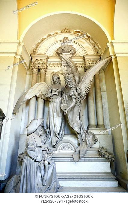 Picture and image of the stone sculptures of angels and a Sister of Charity. in memory of the surgeon Luigi Pastorini, the sculptor Navone has conceived a...
