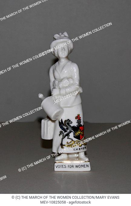 A porcelain figure of a militant suffragette produced as an item of crested ware with the crest of the city of Exeter. The figure of the woman is finely...