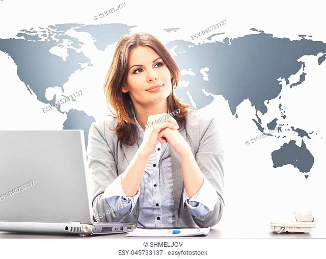 Beautiful business woman in the office on a world map background. Global business concept
