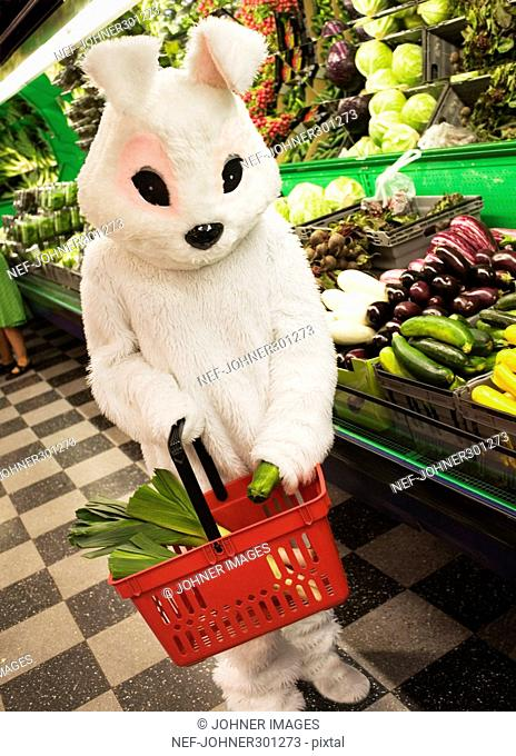A person in a bunny costume shopping