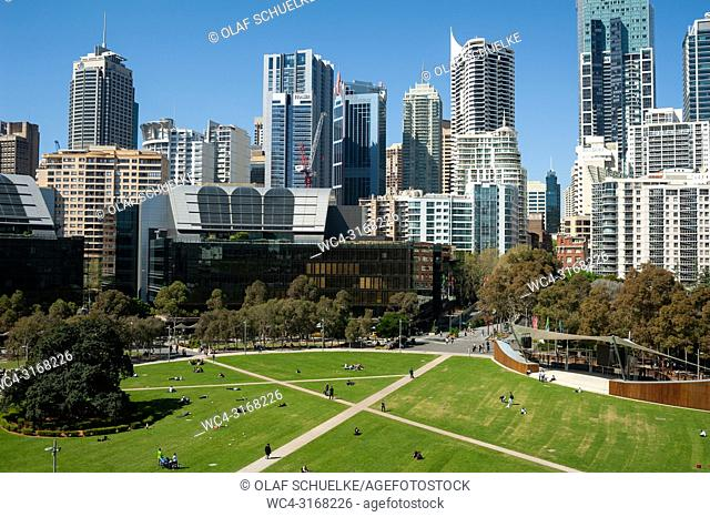 A view of Sydney's cityscape with the central business district and the Tumbalong Park in the foreground. Sydney, New South Wales, Australia