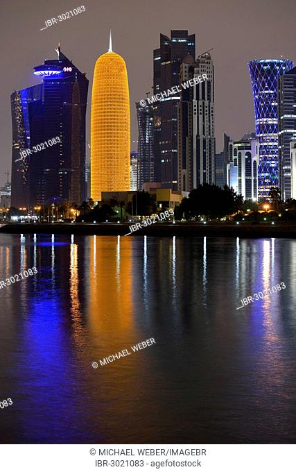 Night scene, skyline of Doha with Al Bidda Tower, World Trade Center, Palm Tower 1 and 2, Burj Qatar Tower with golden illumination, Tornado Tower