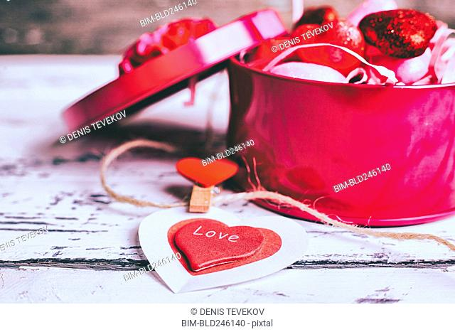 Open box of valentine hearts and decoration on string