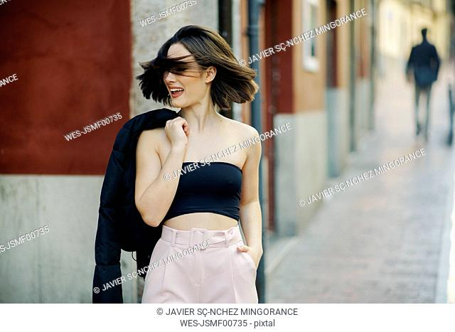 Portrait of fashionable young woman in the city