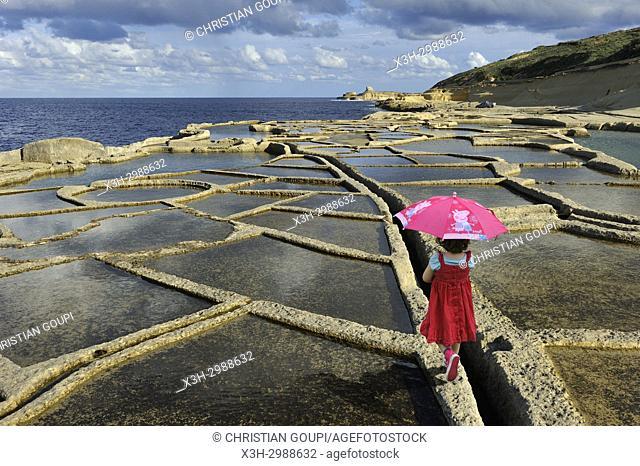 little girl in salt pans on the north coast of Gozo Island, Malta, Mediterranean Sea, Southern Europe