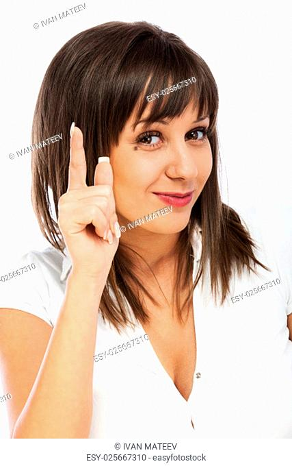 Cheerful caucasian woman with her finger on her head, expressing having an idea, isolated on white background