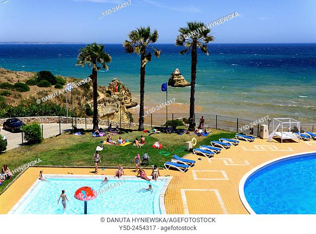 Europe , Portugal, Algarve , Western Algarve, Faro district , Lagos , touristic resort with swimming-pools above famous Dona Ana beach