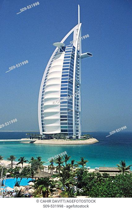 The 7 star luxury Burj al Arab Hotel seen from the grounds of the 5 Star luxury Jumeirah Beach Resort Hotel at Jumeirah Beach, Dubai, United Arab Emirates