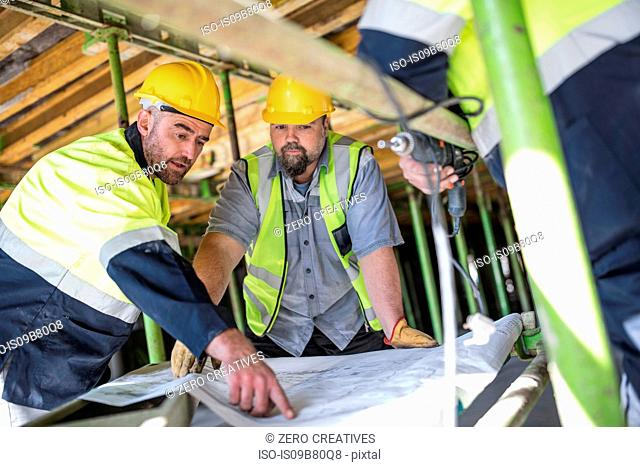 Construction workers looking at plans