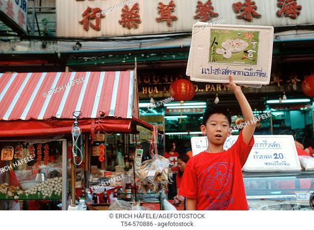 Young Chinese Showing Menu