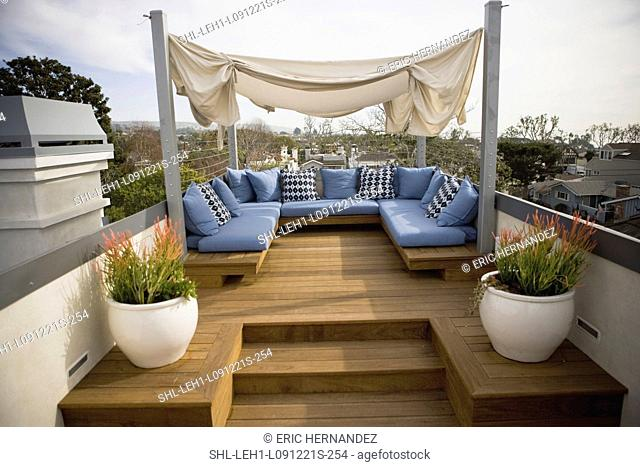 Rooftop sitting area with blue cushions