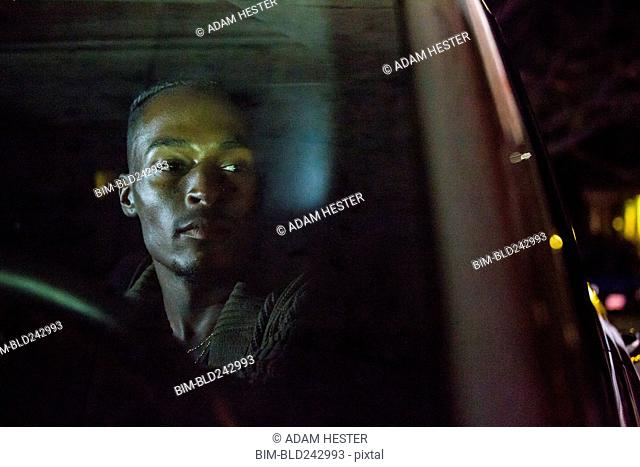 Black man driving car