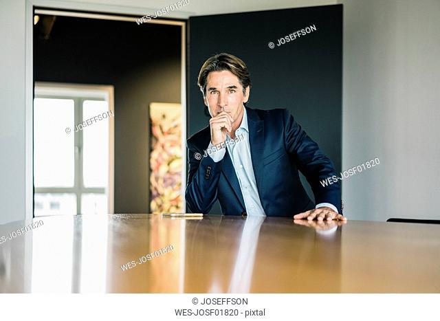 Portrait of businessman in meeting room of an office