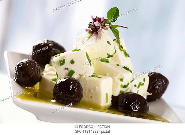 A salad of feta cheese, black olives, olive oil and oregano