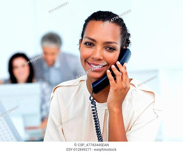 Positive businesswoman calling by phone