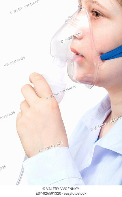 medical inhalation treatment - girl inhales with face mask of modern jet nebulizer isolated on white background