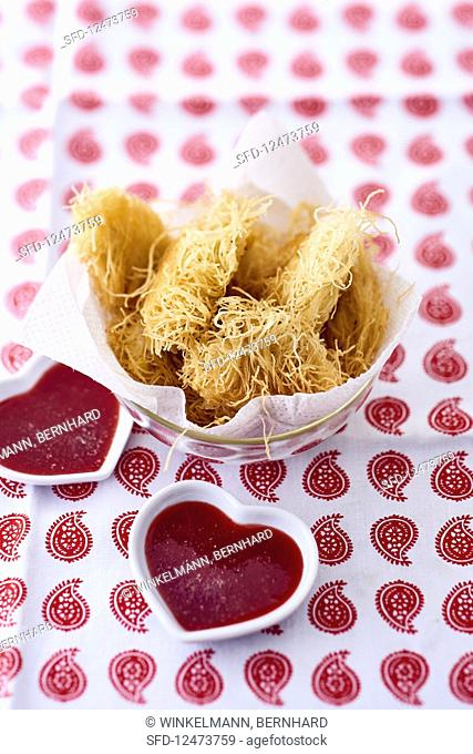 Kataifi coated chicken strips with dips in heart shaped bowls