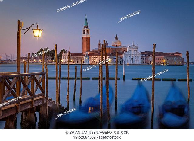 Early morning view of bobbing gondolas with San Giorgio Maggiore beyond, Venice Veneto Italy