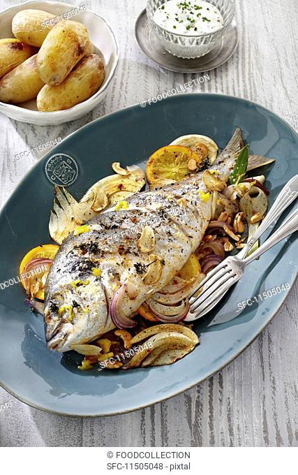 Seabream on a fennel medley with new potatoes and a herb sauce