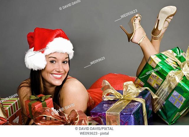 A beautiful caucasian woman in sexy Santa lingerie