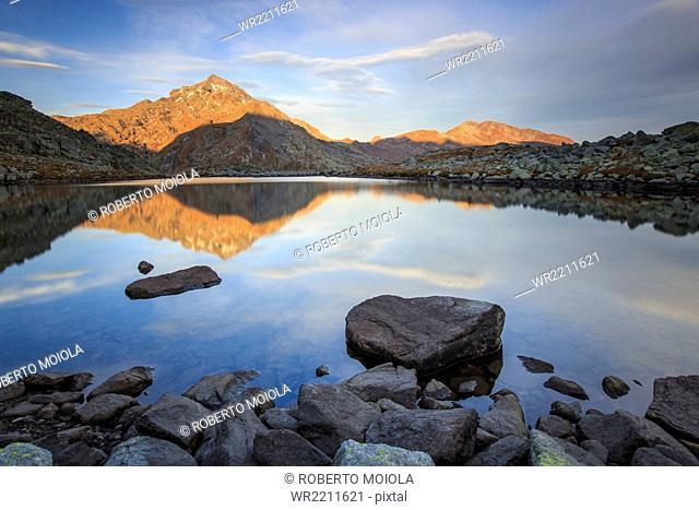 Peak Tambo reflected in Lake Bergsee at dawn, Chiavenna Valley, Spluga Valley, Switzerland, Europe