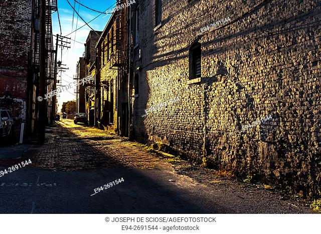 A view down an old city alley with long afternoon shadows. Birmingham, Alabama, USA