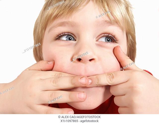Little boy pulling a face
