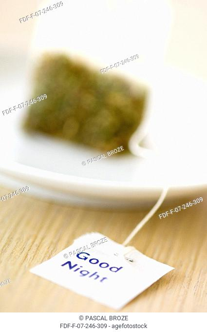 Close-up of a herbal teabag in a plate